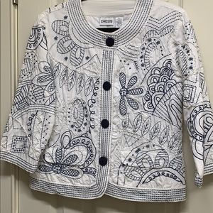 Cotton jacket with blue embroidery.